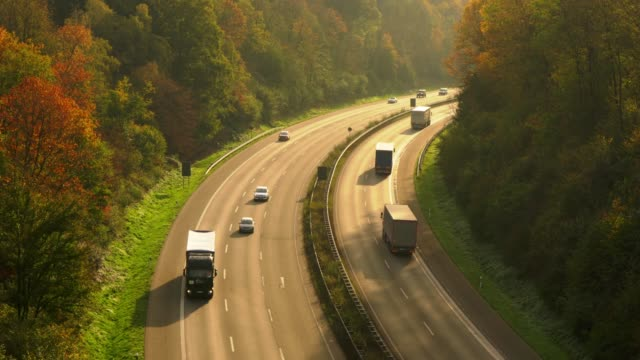 motorway in autumn - articulated lorry stock videos & royalty-free footage