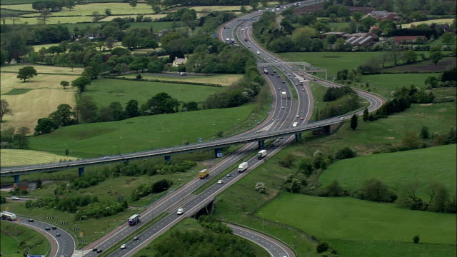 motorway junction - aerial view - england, united kingdom - lancashire stock videos & royalty-free footage