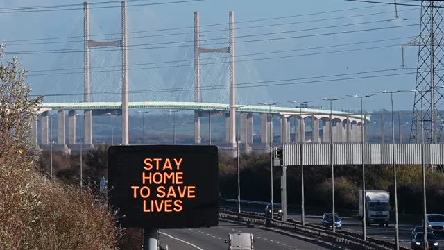 """motorway matrix sign which says """"stay home to save lives"""" in front of the prince of wales bridge, formerly the severn bridge, which connects wales... - stay at home order stock videos & royalty-free footage"""