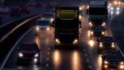 Motorway morning traffic in the rain.