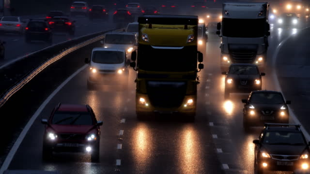 motorway morning traffic in the rain. - furgone video stock e b–roll
