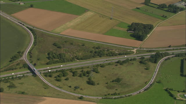 vidéos et rushes de aerial, motorway n27 surrounded with fields, haute normandy, france - patchwork landscape
