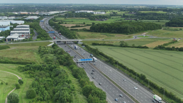 m1 motorway on the edge of leicester - aerial view - motorway stock videos & royalty-free footage
