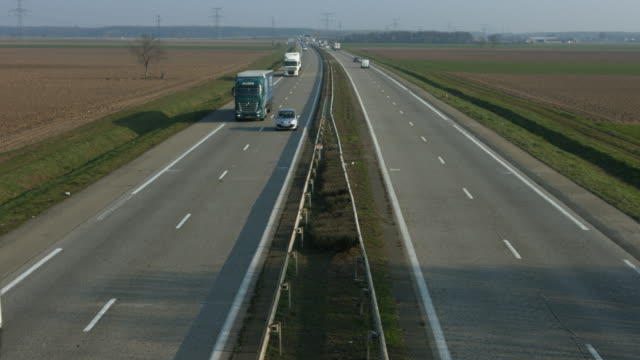 Motorway perspective view with active traffic