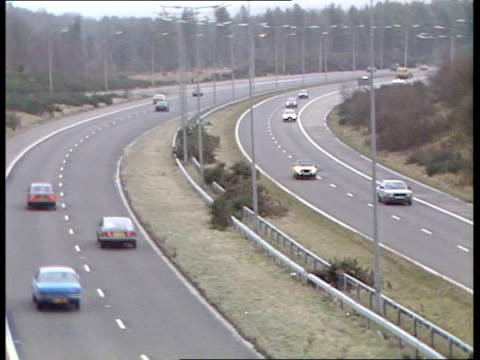 motorway safety / government review england surrey tgv vehicles along motorway in both directions bv cars along motorway as overhead signs indicate... - tgv点の映像素材/bロール