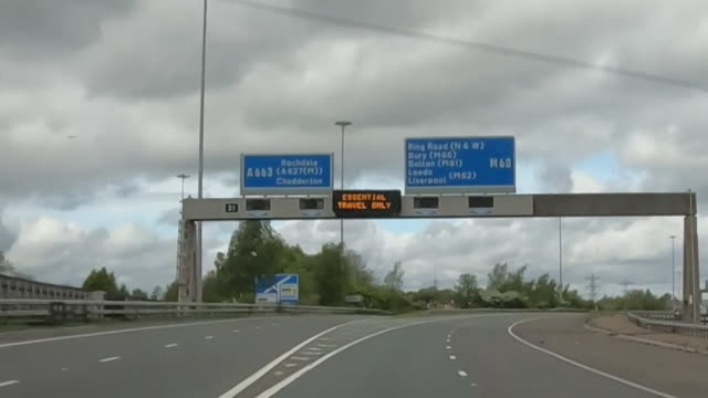 m60 motorway to leeds very empty with sign saying essential travel only during coronavirus lockdown - major road stock videos & royalty-free footage
