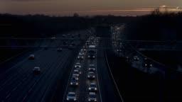 Motorway traffic M25 at dusk.