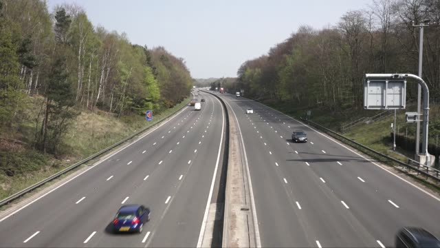 motorway traffic on the m3 and m4 appears to be slowing as authorities fear hot weather and boredom may tempt people into flouting the rules during... - boredom stock videos & royalty-free footage