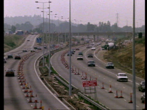 t/l motorway traffic passing through road works - traffic cone stock videos & royalty-free footage