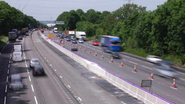m1 motorway traffic traveling through road works. - traffic cone stock videos & royalty-free footage