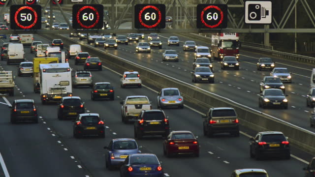m25 motorway traffic - speed limit sign stock videos & royalty-free footage