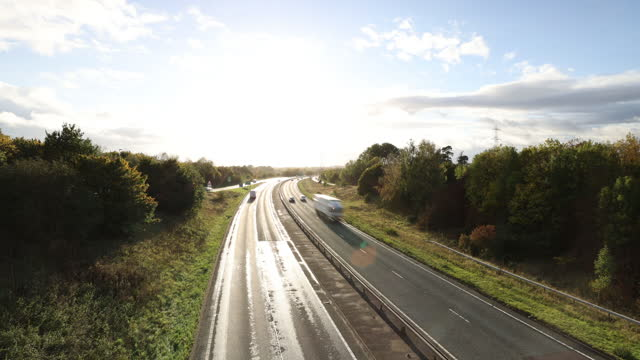 motorway transport time lapse - forest stock videos & royalty-free footage
