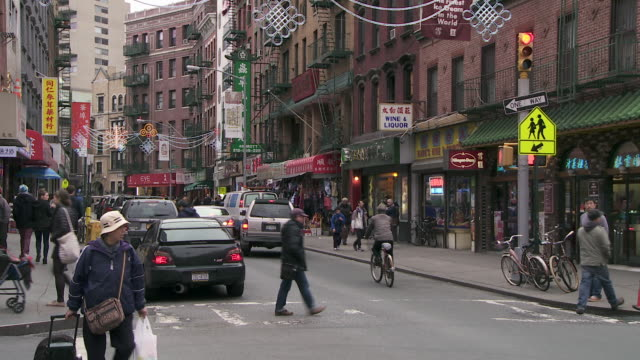 a ws of mott st in chinatown during the wintertime. - chinatown stock videos & royalty-free footage