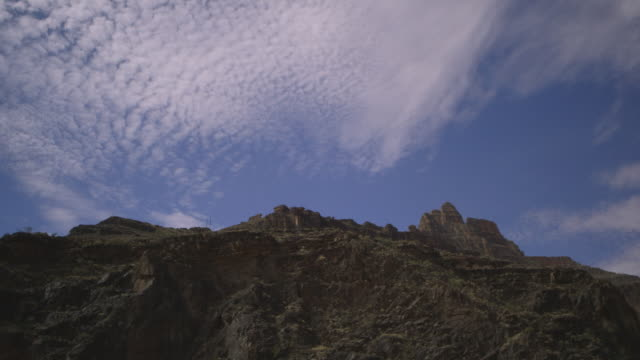 mottled cloud passes over rock of the grand canyon, arizona, usa. - arizona stock videos & royalty-free footage