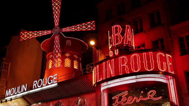 moulin rouge at night, paris, france - revue stock videos and b-roll footage