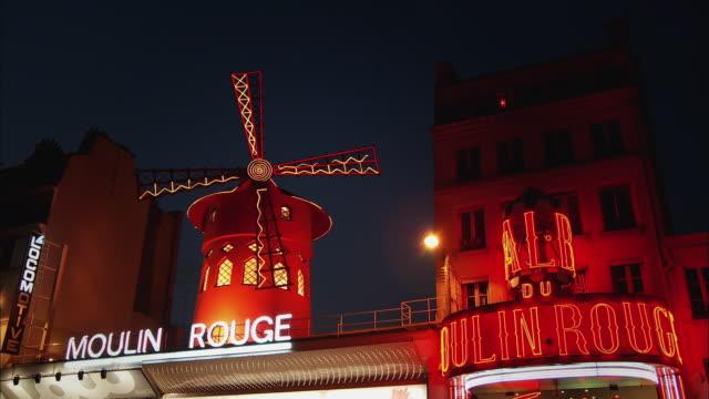 ms, la, moulin rouge illuminated at night, paris, france - cabaret stock videos & royalty-free footage