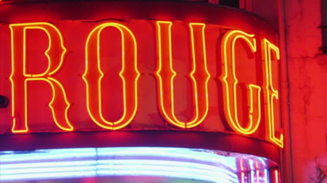 cu pan tu moulin rouge windmill illuminated at night, paris, france - neon video stock e b–roll