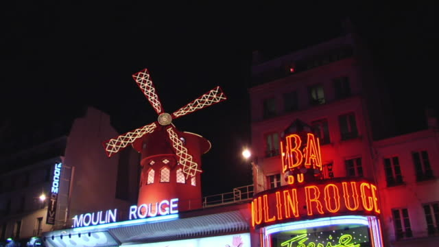 ms zi cu moulin rouge windmill illuminated at night, paris, france - cabaret stock videos & royalty-free footage