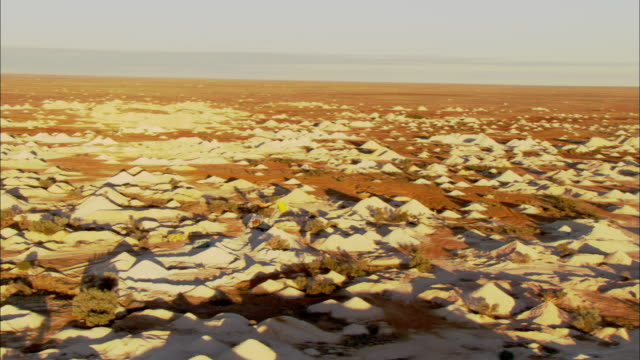 mounds of dirt surround a large machine at the coober pedy opal mines. - coober pedy stock videos & royalty-free footage