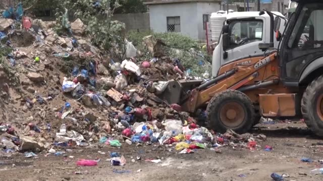mounds of stinking garbage line the streets of yemen's historic city of taez once renowned as one of the most beautiful places in the country but now... - vibrio stock videos & royalty-free footage