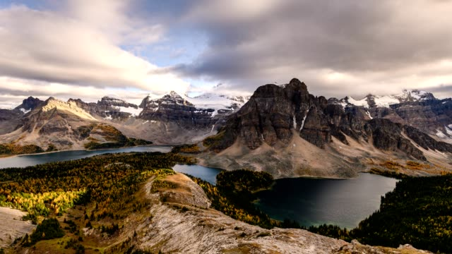 mount assiniboine with cloud flowing on nublet peak with lakes on sunset at provincial park - banff national park stock videos & royalty-free footage