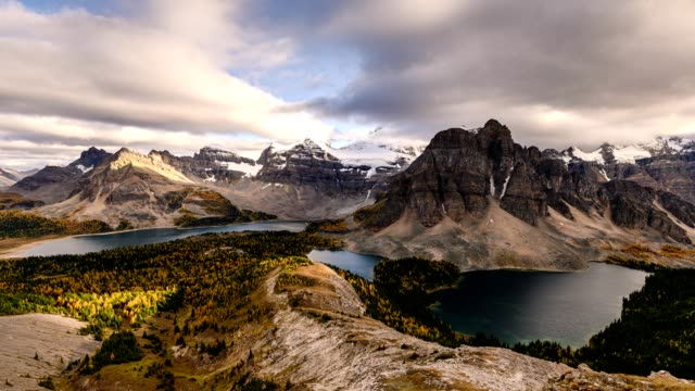 mount assiniboine with cloud flowing on nublet peak with lakes on sunset at provincial park - alberta stock videos & royalty-free footage