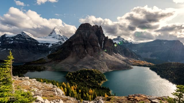 mount assiniboine with rocky mountain and sunburst and cerulean lake in provincial park at canada - banff national park stock videos & royalty-free footage