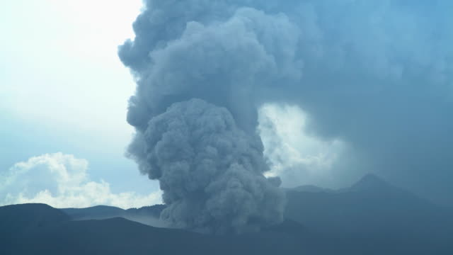 mount bromo eruption smoke and ash java indonesia - bromo crater stock videos & royalty-free footage