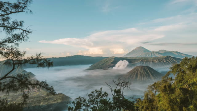 mount bromo volcano during sunrise, east java, indonesia. - indonesia volcano stock videos & royalty-free footage