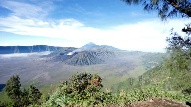 mount bromo with smoke, mount batok at front, mt kursi and mt gunung semeru at back, volcano, eruption, bromo tengger semeru. - tengger stock videos & royalty-free footage
