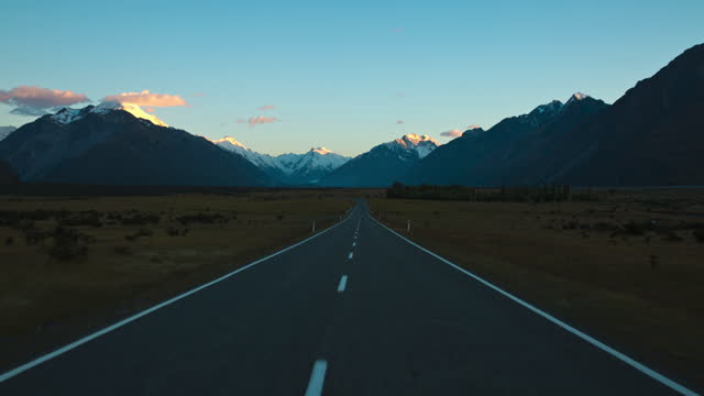 mount cook and car movement on road / new zealand - mountain range stock videos & royalty-free footage