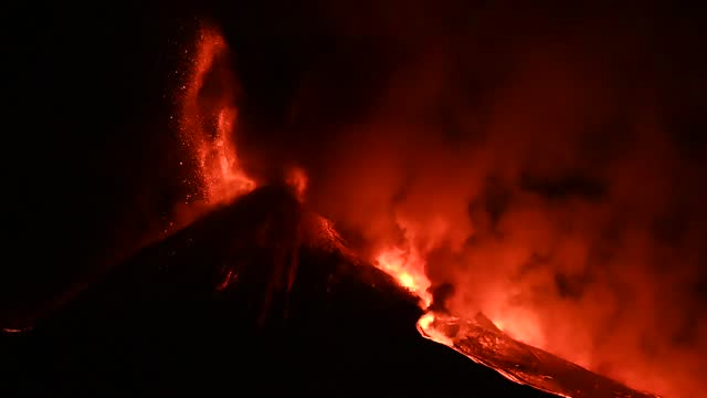 mount etna spews lava, ash and volcanic rock toward the bove valley on february 24, 2021 in catania, italy. etna, shown from the southeast crater, is... - lava stock videos & royalty-free footage