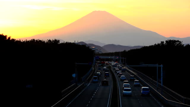 Mount Fuji and traffic at sunset.