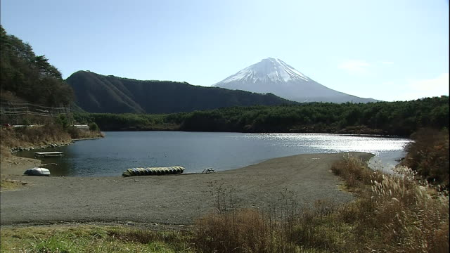 Mount Fuji looms over Lake Saiko in the Fuji Hakone Izu National Park in Yamanashi, Japan.
