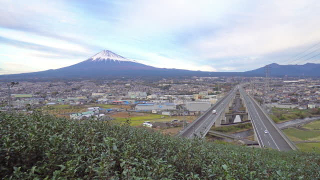 mount fuji with expressway and tea crop - day to night - time lapse - shizuoka prefecture stock videos and b-roll footage