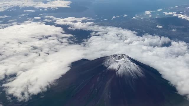 mount fuji's first snowcap of the season was observed tuesday morning, september 7 in tokyo, japan. the snowcap of the mountain was observed in early... - snowcapped mountain stock videos & royalty-free footage