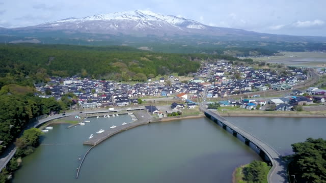 ws aerial mount gassan and coastal town with marina, yamagata prefecture, japan - town stock videos & royalty-free footage
