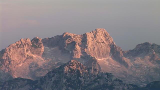 ms, pan, mount jalovec in morning light, triglav national park, gorenjska, slovenia - triglav national park stock videos and b-roll footage