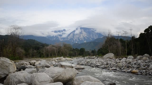Mount Kinabalu and river flowing in Sabah Borneo