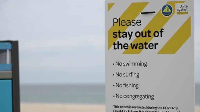 mount maunganui beach closed to swimmers during covid19 lockdown - lockdown stock videos & royalty-free footage