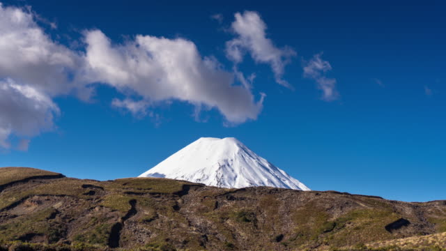 mount ngauruhoe capped with snow - time lapse - tongariro national park stock videos & royalty-free footage