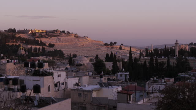 mount of olives in jerusalem at dusk/sunset - time lapse - spoonfilm stock-videos und b-roll-filmmaterial