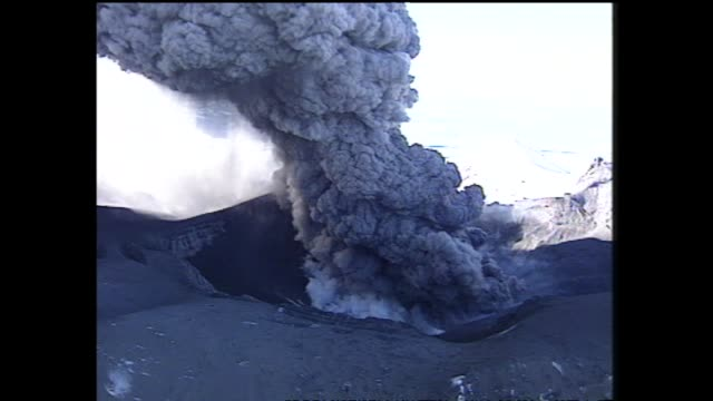 Mount Ruapehu eruption with aerial views of billowing pillar of steam and ash rising from crater lake