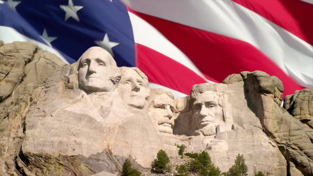 mount rushmore and american flag - mt rushmore national monument stock videos and b-roll footage
