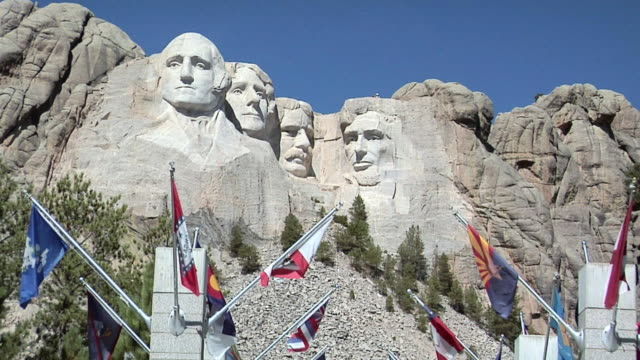 ZO WS Mount Rushmore National Memorial with international flags in foreground, South Dakota, USA