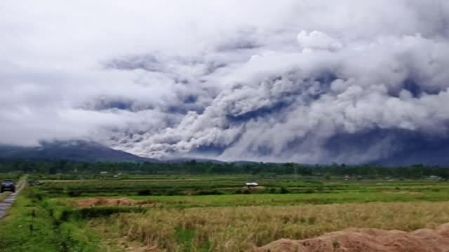 mount semeru on java island spewed hot ash 2.8 miles into the air as it erupted late saturday - volcano stock videos & royalty-free footage