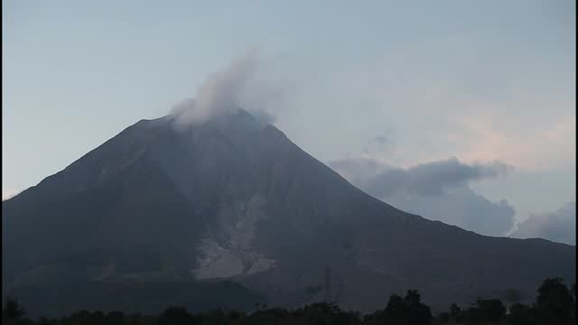 mount sinabung smoke into the air after lava flowing from the top of a volcano on the island of sumatra on february 16 in karo, indonesia. rumbling... - three quarter length stock videos & royalty-free footage