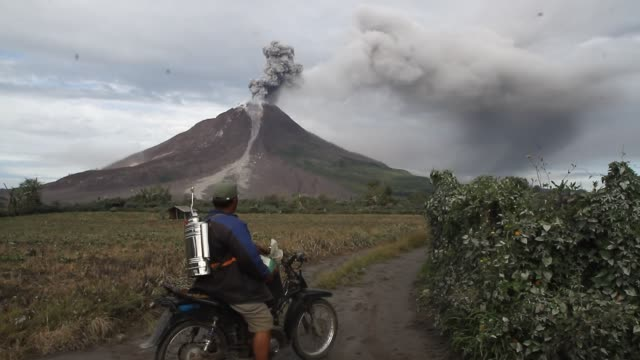 mount sinabung volcano an eruption in north sumatra - ash stock videos & royalty-free footage