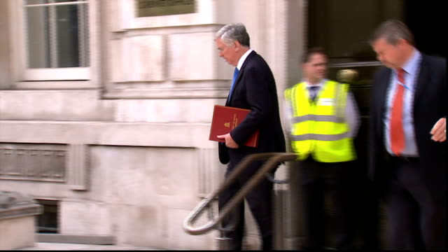 thousands flee to refugee camps / british aid drop; england: london: ext michael fallon mp leaving cabinet office after cobra meeting - sinjar mountains stock videos & royalty-free footage