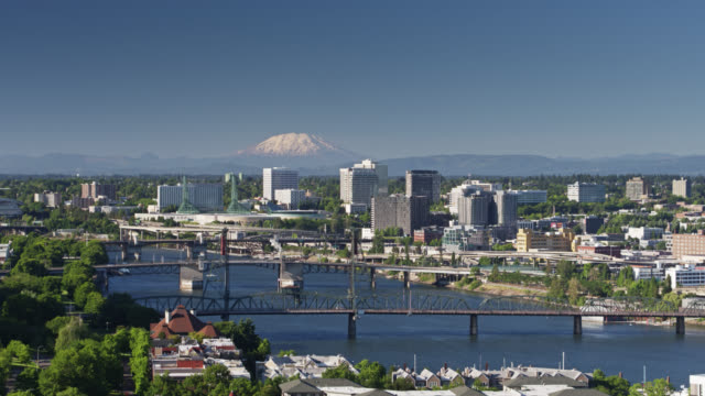 mount st helens rising in distance over downtown portland - aerial - portland oregon stock videos & royalty-free footage